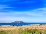 Bien xanh may trang nang vang o Jeju