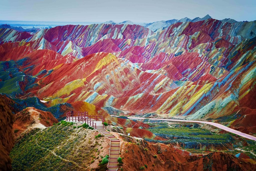 """""""A visitor stands at a viewing platform in the Zhangye Danxia Landform Geological Park in Zhangye, northwest Chinas Gansu province, 22 September 2012."""""""